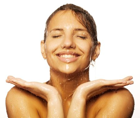 female in douche: woman face with water drop Stock Photo