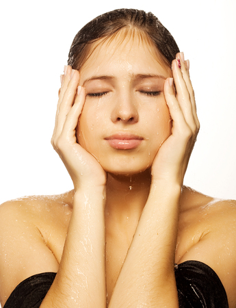 female with a drops of water on her pure face Stock Photo
