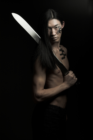 asian man over black background Stock Photo