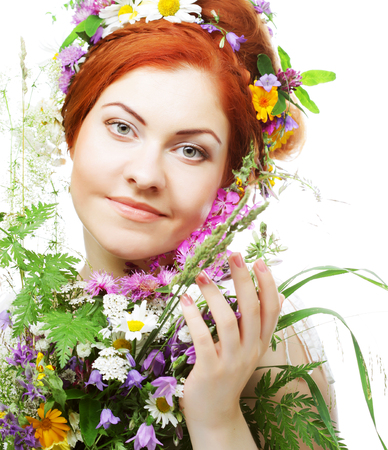 gracefully: woman with large hairstyle and flowers Stock Photo
