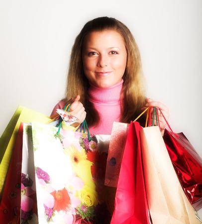 clothing store: Shopping beauty girl on white background Stock Photo