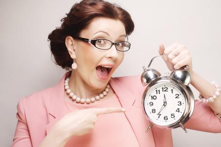 alarmclock: Young  woman with alarmclock