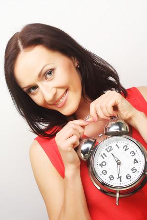 alarmclock: Young happy woman with alarmclock