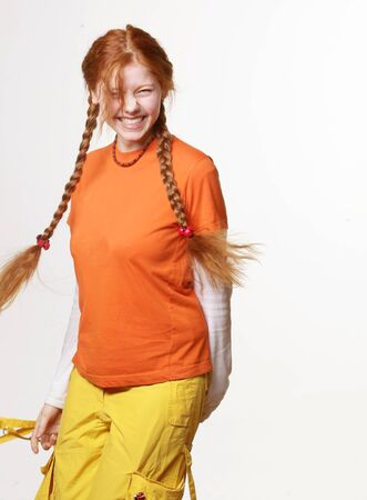 lovely redhead girl with long braids