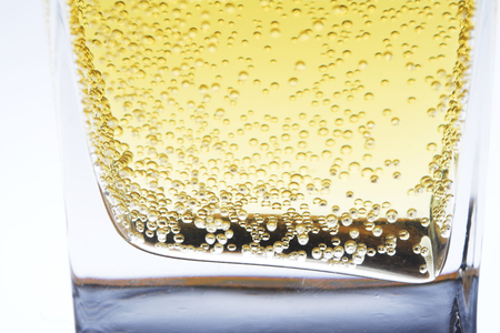 intoxicate: Close up of beer fizzy in a glass