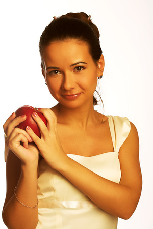 Pretty young smiling woman with red apple.