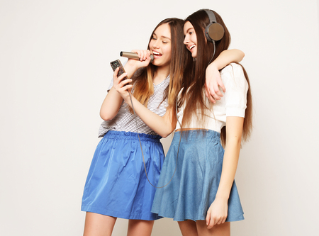 beauty hipster girls with a microphone singing and take picture