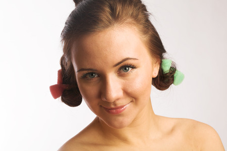 hair roller: Beautiful girl with hair curlers Stock Photo