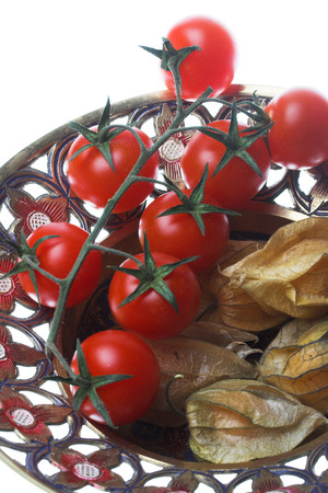 Winter cherry and tomatos on the plate