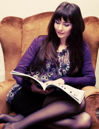 female reading a magazine at tea time Stock Photo