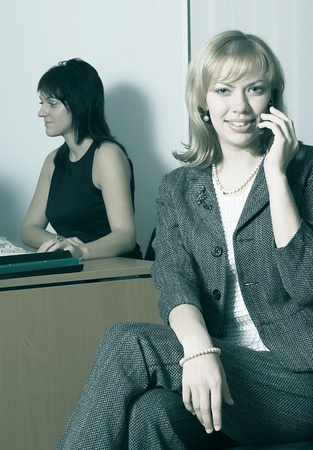 Businesswoman in a office environment Stock Photo