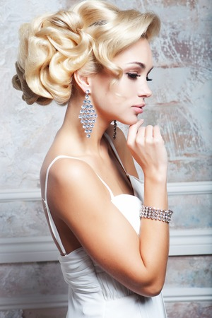 Beautiful bride with fashion wedding hairstyle - close up pictur