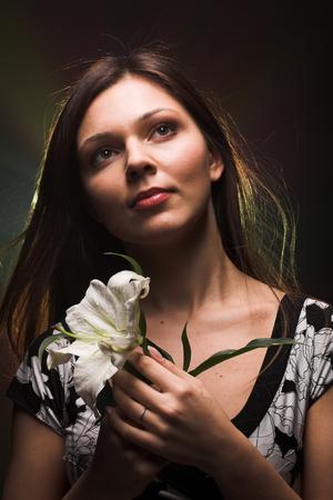 Girl with white lily Reklamní fotografie