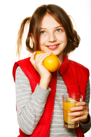 Little girl with oranges and juice Stock Photo