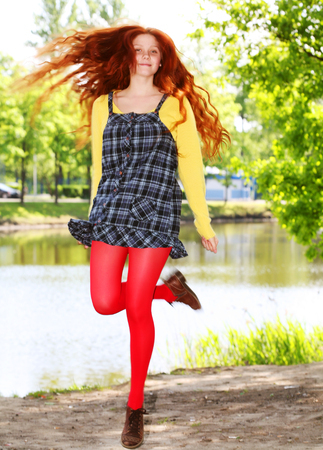 smiling redhaired girl, outdoors Stock Photo