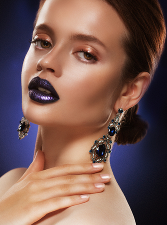Fashion portrait of young beautiful woman with jewelry.