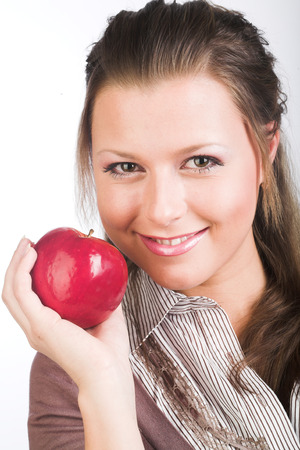 young smiling woman with red apple.