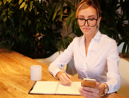 business  and people concept: Modern business woman in city cafe