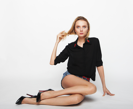 Female fashion model wearing casual clothes and sitting