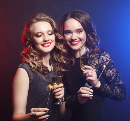 Party time. Two beautiful young women with wine glasses