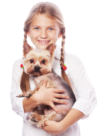 Beautiful  blond girl with cute yorkshire terrier dog, isolated Stock Photo