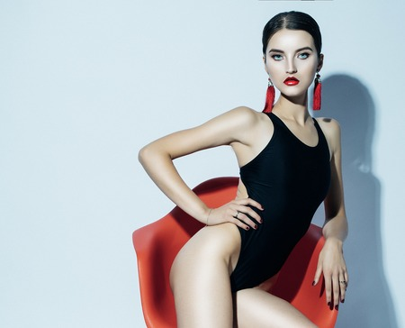 Fashion and people concept: beautiful model woman in black swimsuit Stock Photo