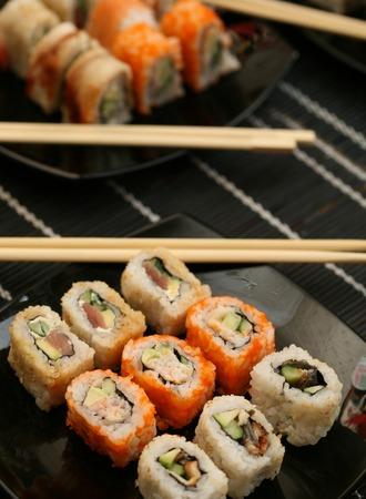 Japanese sushi on black plate Stock Photo