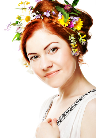 woman with large hairstyle and flowers in her hair. Stock Photo