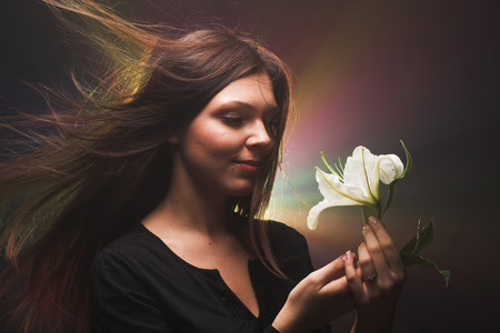 beautiful woman with madonna lily Banco de Imagens