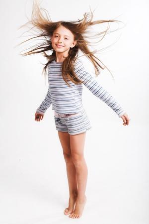 little girl jump over white background