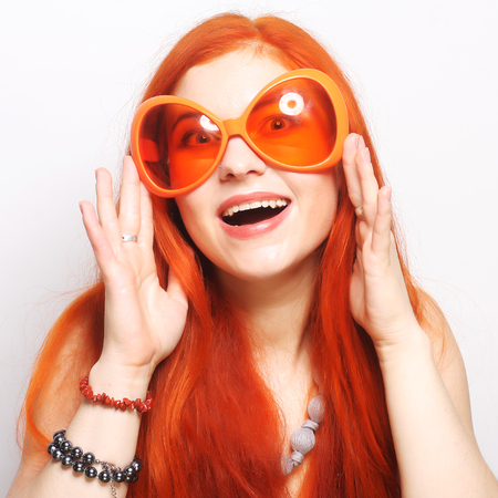 funny redhair woman in big orange glasses