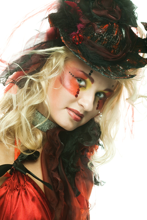 Beautiful lady  in red hat with artistic make-up.
