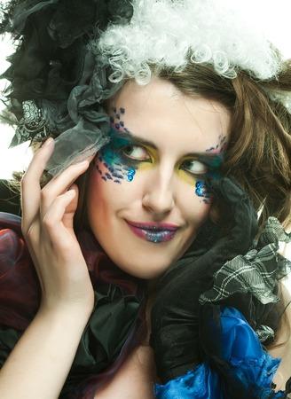 Beautiful woman with artistic make-up. 免版税图像