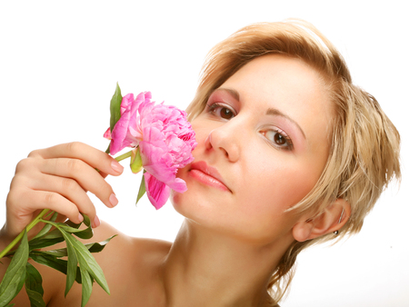 young woman with tree-peony flower Stock Photo
