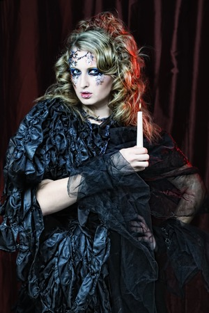 Gothic portrait of woman with candle.