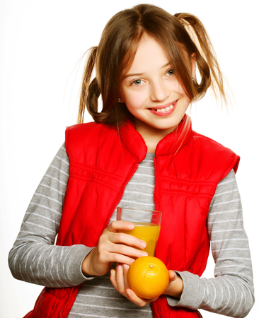Little girl with oranges and juice 版權商用圖片