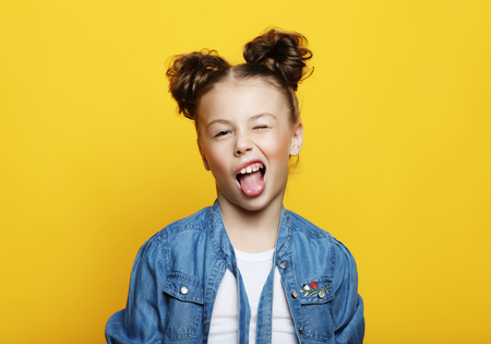 Portrait of little girl  with opened mouth and crazy expression. Surprised or shocked face.