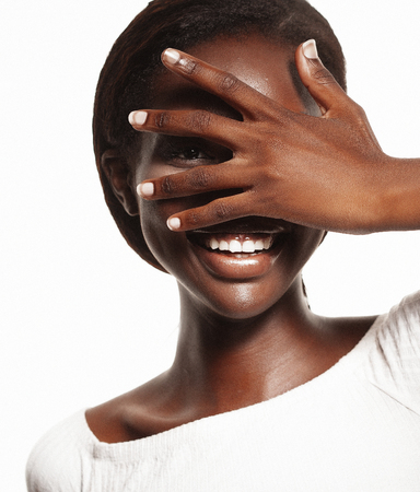 lifestyle and people concept: young african woman laughing with her eyes closed