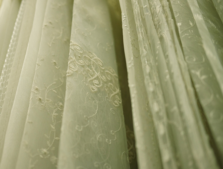 Rolls lace of pastel shades in a fabric store.