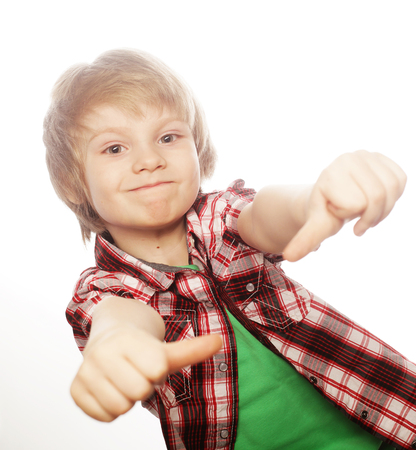 boy raising hand and showing sign of okay