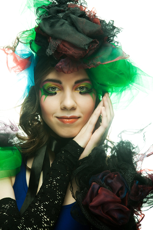 Beautiful woman with artistic make-up. Imagens