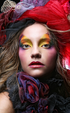 Beautiful lady  with artistic make-up.
