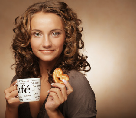 Woman with an aromatic coffee in hands Banco de Imagens - 116943646