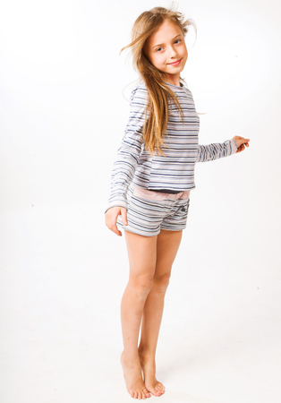 little girl over white background Foto de archivo