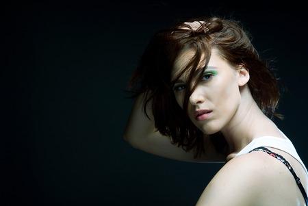 Fashion girl posing on dark background