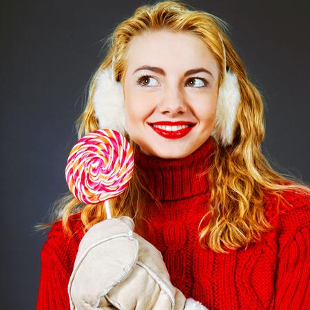 woman holding lollypop Фото со стока