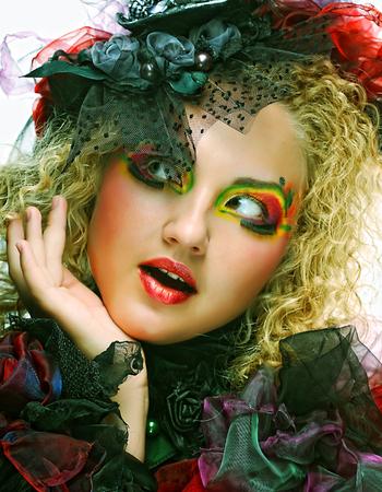 Beautiful woman with artistic make-up. Фото со стока