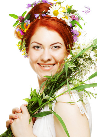 redhair womam with flowers Фото со стока