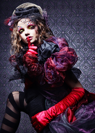 woman in doll style. Creative make-up.Fantasy dress.