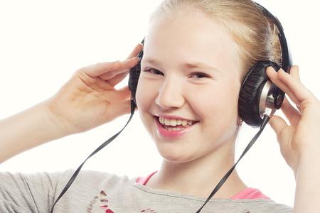 Beautiful happy little girl with headphones Imagens